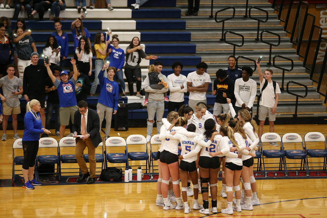 Bishop Gorman players huddle as they get ready for the third set against Palo Verde in the g ...