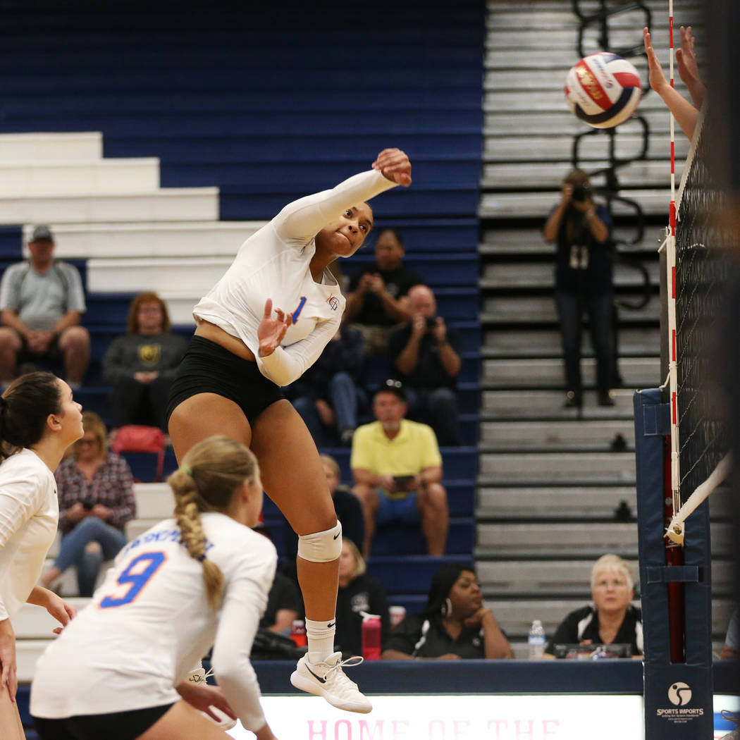 Bishop Gorman's Alexandria Washington (1) connects with the ball against Palo Verde du ...