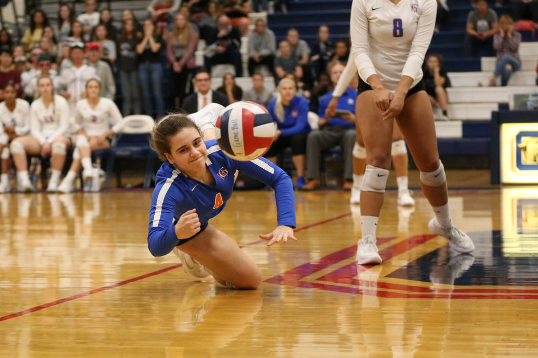 Bishop Gorman's Natalie Mavroidis (4) watches as the ball drops to the floor against P ...