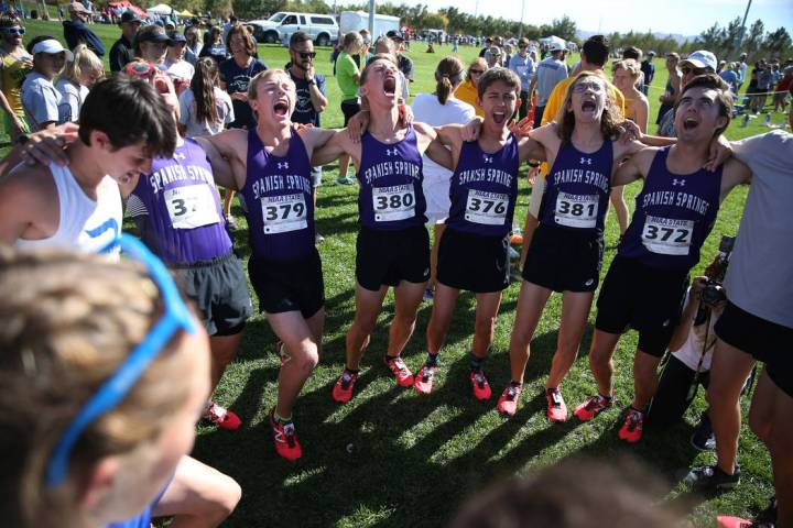 Runners from Spanish Springs High School in Washoe County yell a chant as they get ready to ...