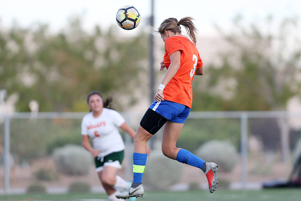 Bishop Gorman's Ashtyn Fink (3) connects with ball for a score against Mojave in the g ...