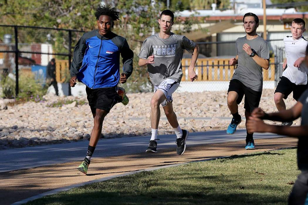 Valley High School cross country runner Christian Franklin, left, practices with his teammat ...