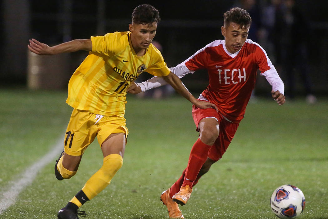 Clark High School's Juan Beltran Diaz fights for the ball against Advanced Technologie ...