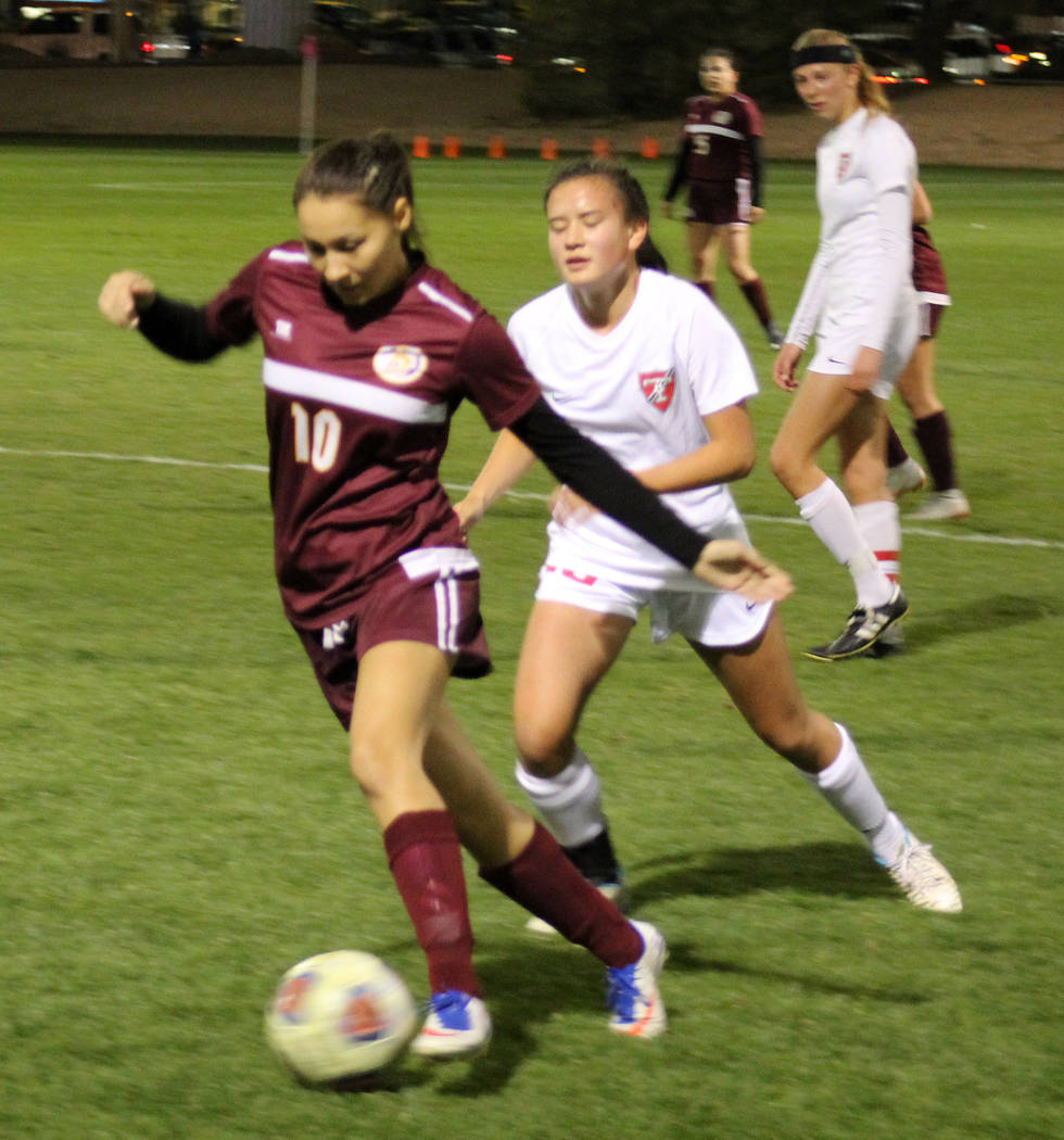 Pahrump Valley's Sofia Castro dribbles past Truckee's Carly Davis in the Class 3 ...