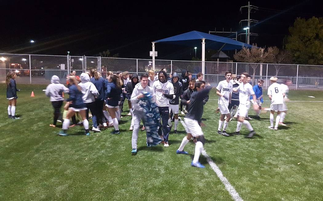 Coronado boys and girls soccer teams celebrates Javier Estrada's game-winning goal aga ...