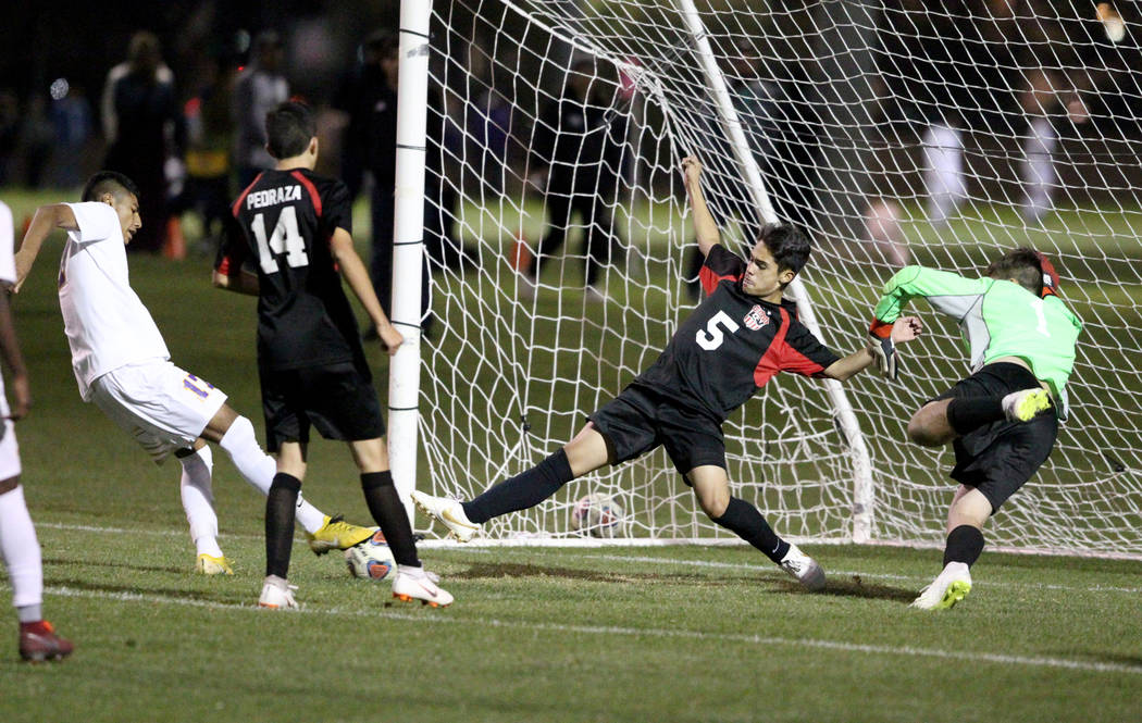 Las Vegas' Sebastian Contreras (5) helps goalie Rodolfo Gomez (1) save a shot by Duran ...