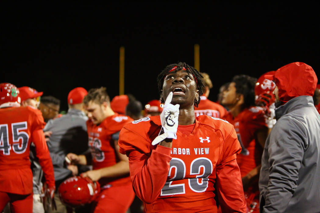 Arbor View's Darius Harrison (23) celebrates the win over Desert Pines during second h ...