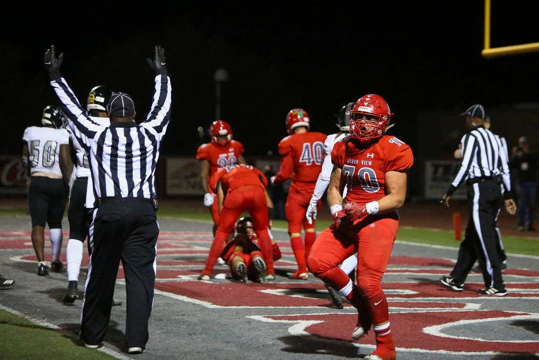 Arbor View's Tyler Kincheloe (70) celebrates after Arbor View's Logan Bollinger ...