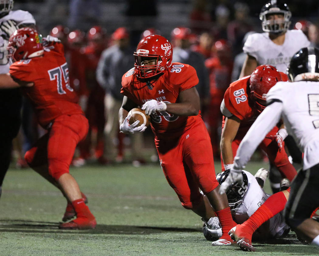 Arbor View's Darius Williams (30) runs through a pocket during second half of the Moun ...