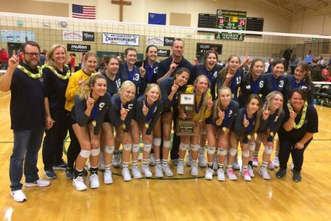 Boulder City's girls volleyball team poses after winning the Class 3A state championsh ...