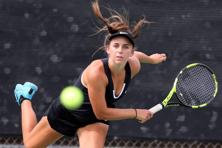 Clark junior Audrey Boch-Collins serves during a dual match at Green Valley High School Wedn ...
