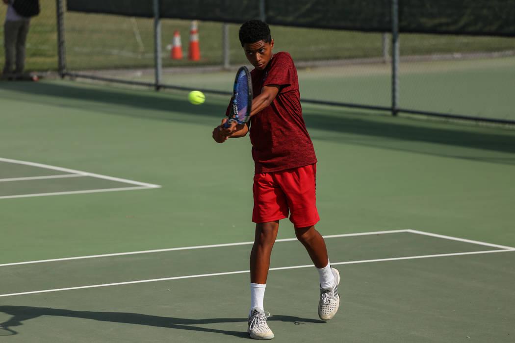 Rua Elmore of Western High plays against Sunrise Mountain's boys tennis team at Wester ...