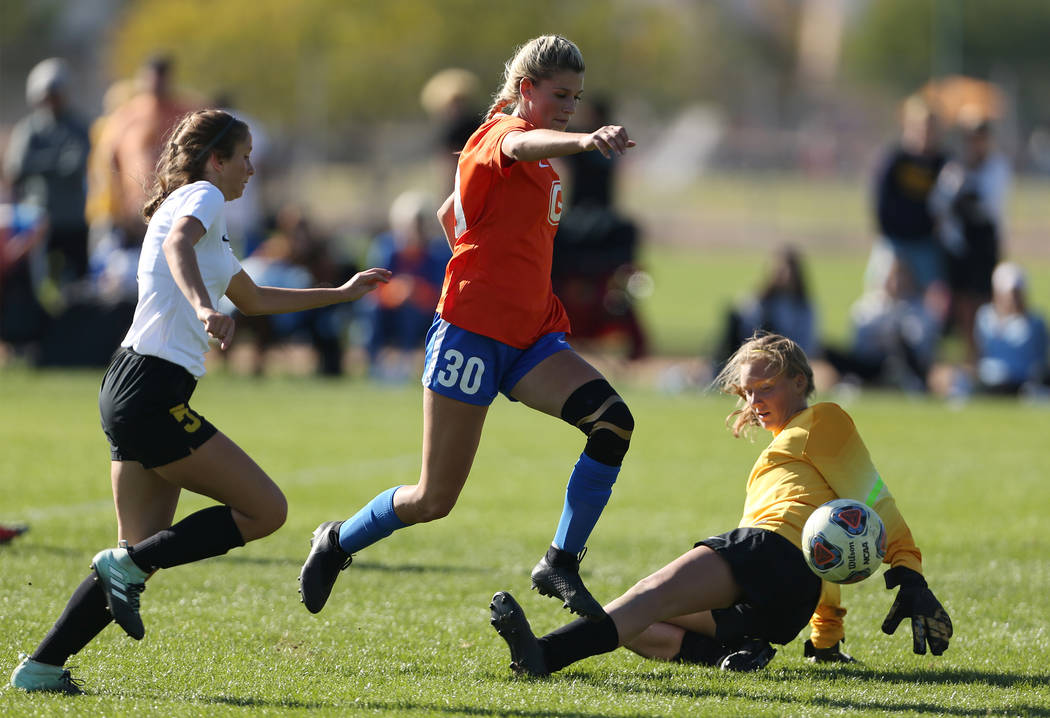 Bishop Gorman's Gianna Gourley (30) leaps over Galena's goalkeeper Ava Gotchi (1 ...