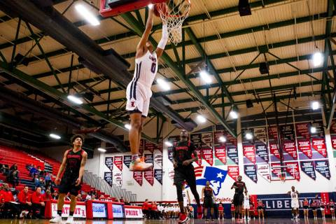 Liberty's Julian Strawther (0) dunks while playing against Las Vegas at Liberty High S ...