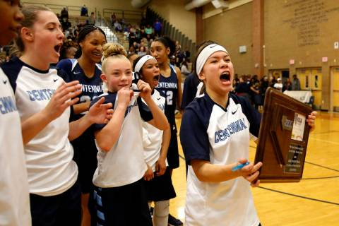Centennial's Melanie Isbell, right, celebrates with her team after beating Spring Vall ...