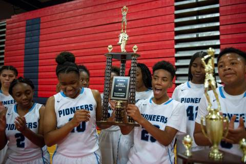 Canyon Springs holds its trophy after defeating Liberty during the second half of the Champi ...