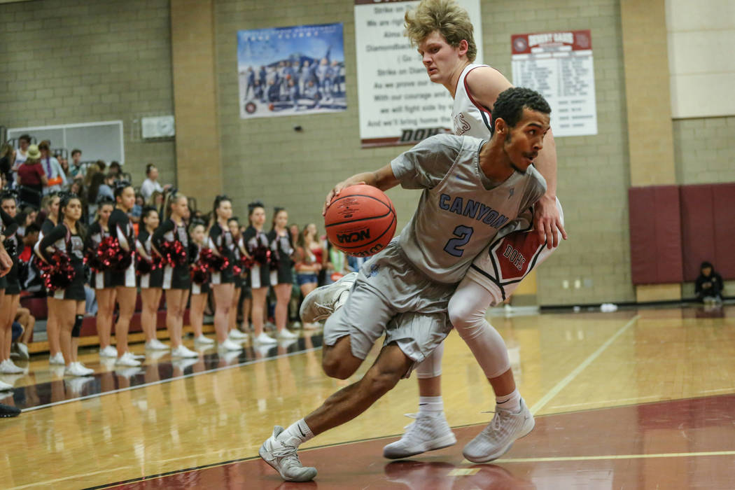 Canyon Springs' Alexander Spaight (2), left, dribbles the ball as he is guarded by Des ...