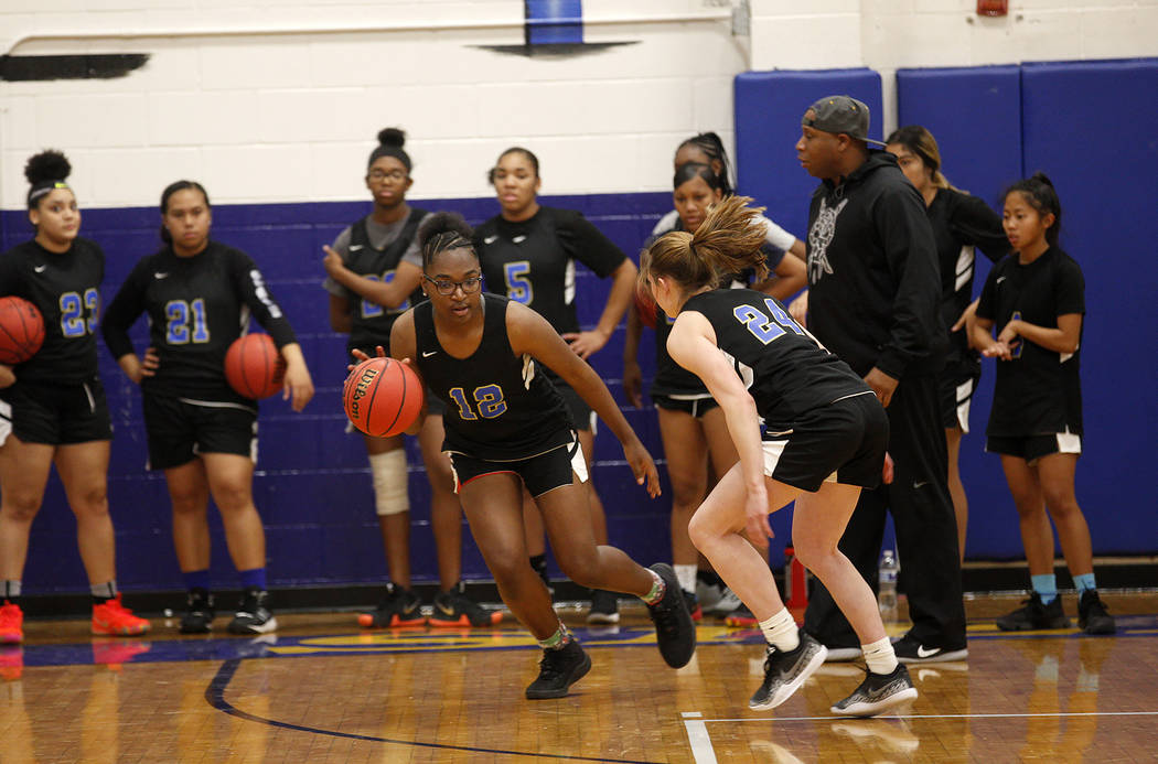 Shania Harper (12), a senior forward on the Sierra Vista High School varsity basketball team ...