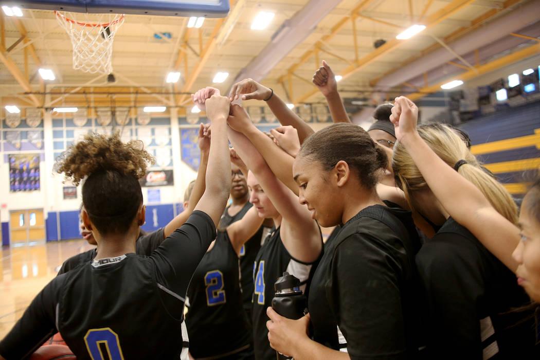 Sierra Vista High School's girls basketball varsity team cheers together in a huddle d ...