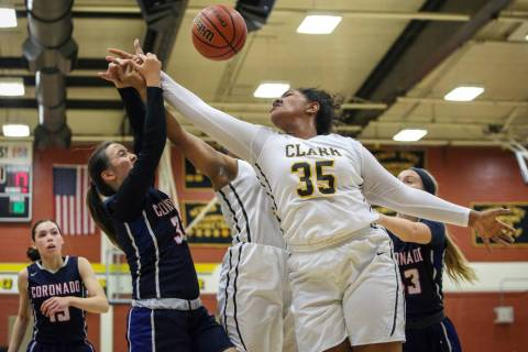 Coronado's Alexee Johnson (35) and Clark's Coraly Dupree (35) reach to grab the ...