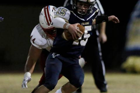 Liberty High's defensive end Luke Toomalatai (44) tackles Foothill's High quarte ...