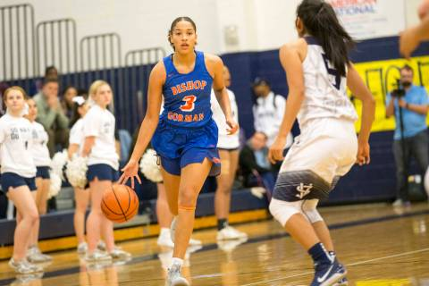 Bishop Gorman's Georgia Ohiaeri (3) dribbles the ball as Spring Valley's Chelsea ...