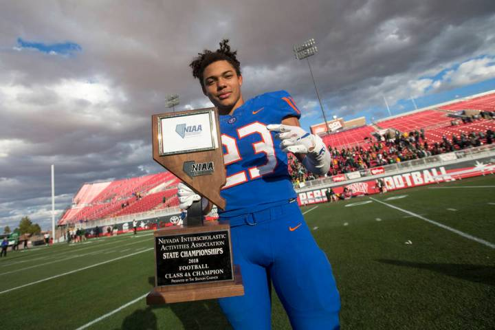 Bishop Gorman running back Amod Cianelli (23) celebrates with the trophy after Gorman defeat ...