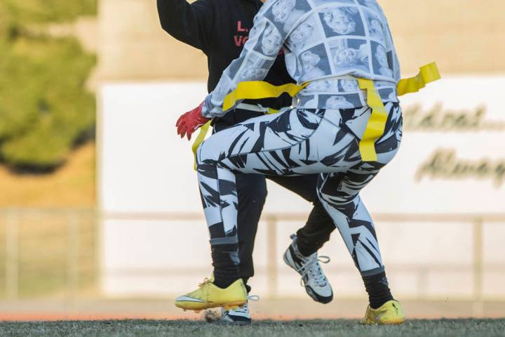 Las Vegas quarterback Sabrina Saldate dishes the ball before being tackled during flag footb ...