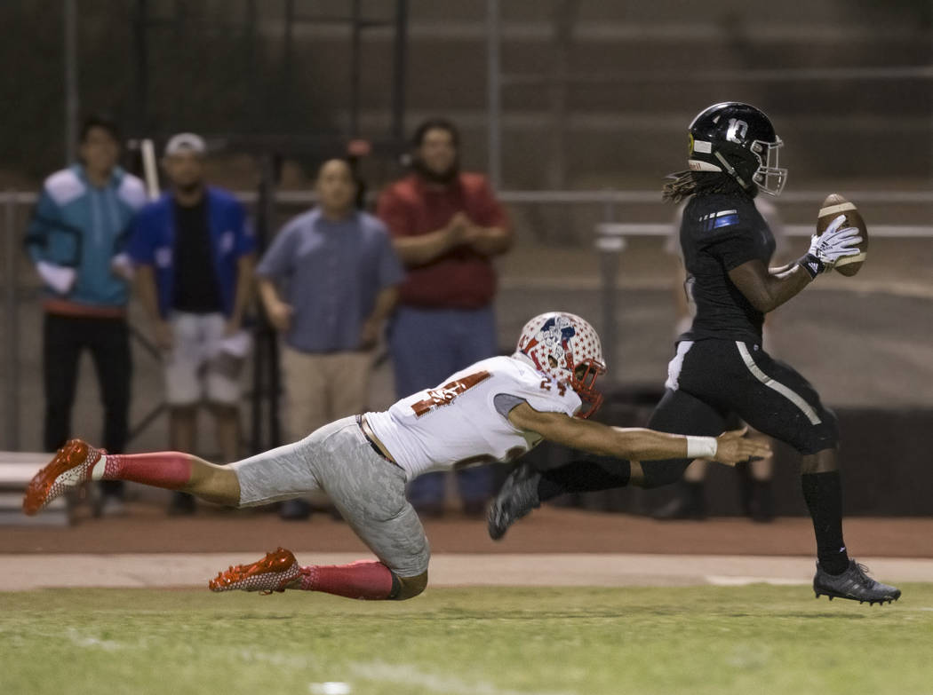 Desert Pines senior wide receiver Devin McGee (10) catches a second quarter touchdown pass a ...