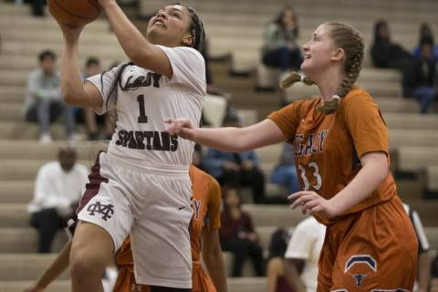 Cimarron-Memorial's Elise Young (1) goes up for a shot against Legacy in the girls bas ...