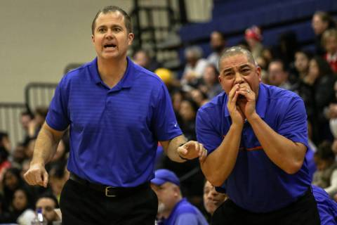 Bishop Gorman head coach Grant Rice, left, and assistant coach Rich Thornton react during th ...