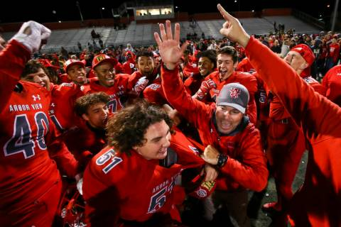 Arbor View head coach Dan Barnson, right, joins his players in celebrating their win over Fa ...