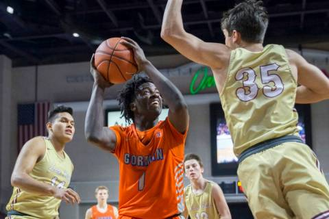 Bishop Gorman sophomore guard Will McClendon (1) elevates over Lone Peak junior guard Trey G ...