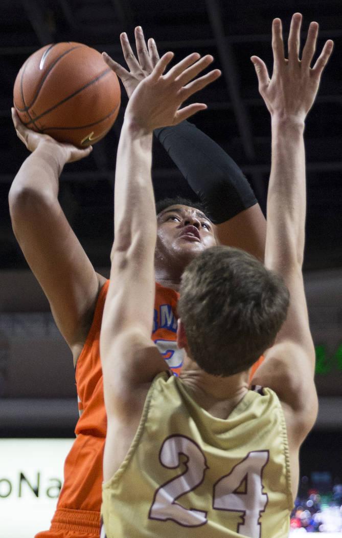Bishop Gorman freshman forward Max Allen (12) shoots a jump shot over Lone Peak junior forwa ...