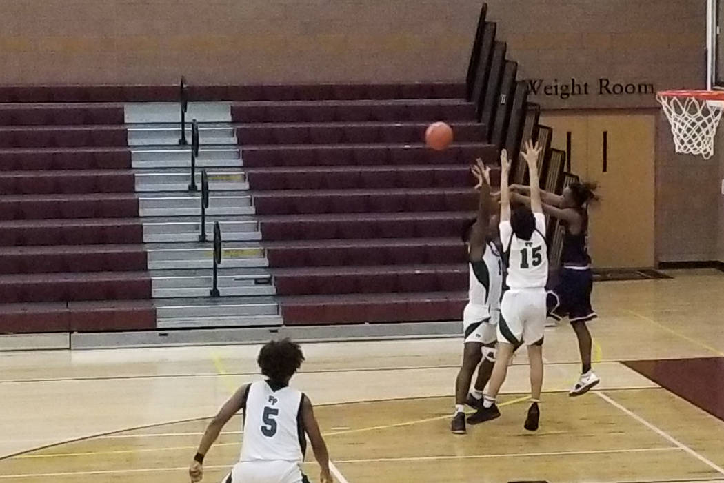 Legacy guard Rayshon Funches passes out of a trap against Fairmont (California) during the T ...