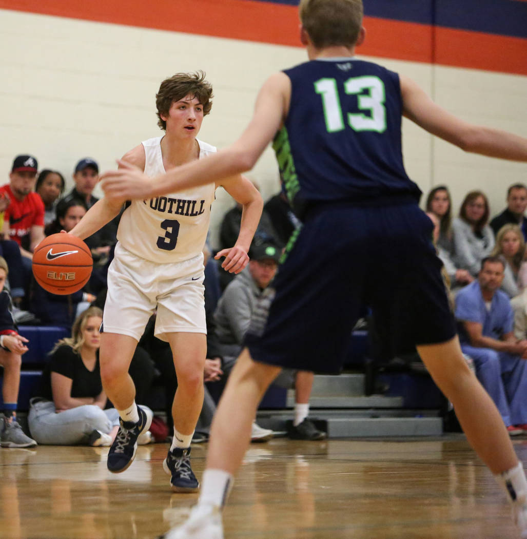 Foothill's Collin Russell (3) dribbles the ball against Timpanogos' Jackson Holc ...
