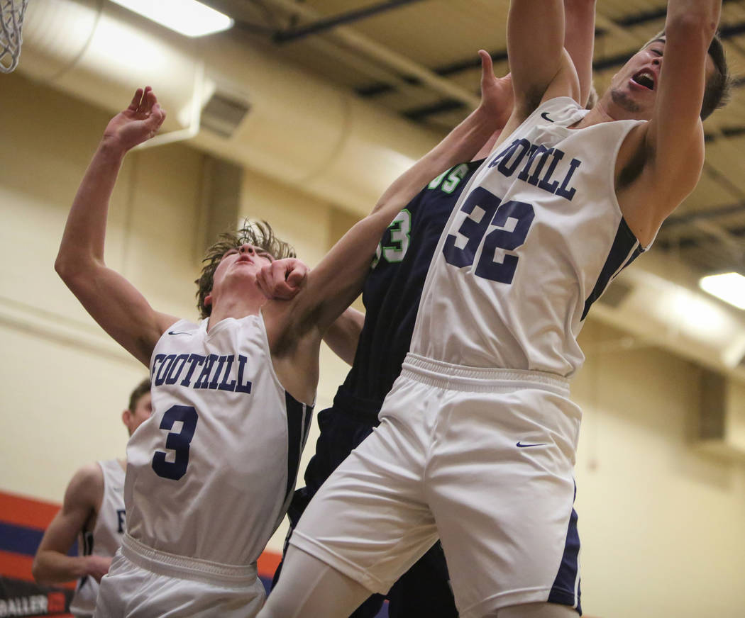 Foothill's Collin Russell (3), left, Timpanogos' Mckay Meeves (33) and Foothill& ...