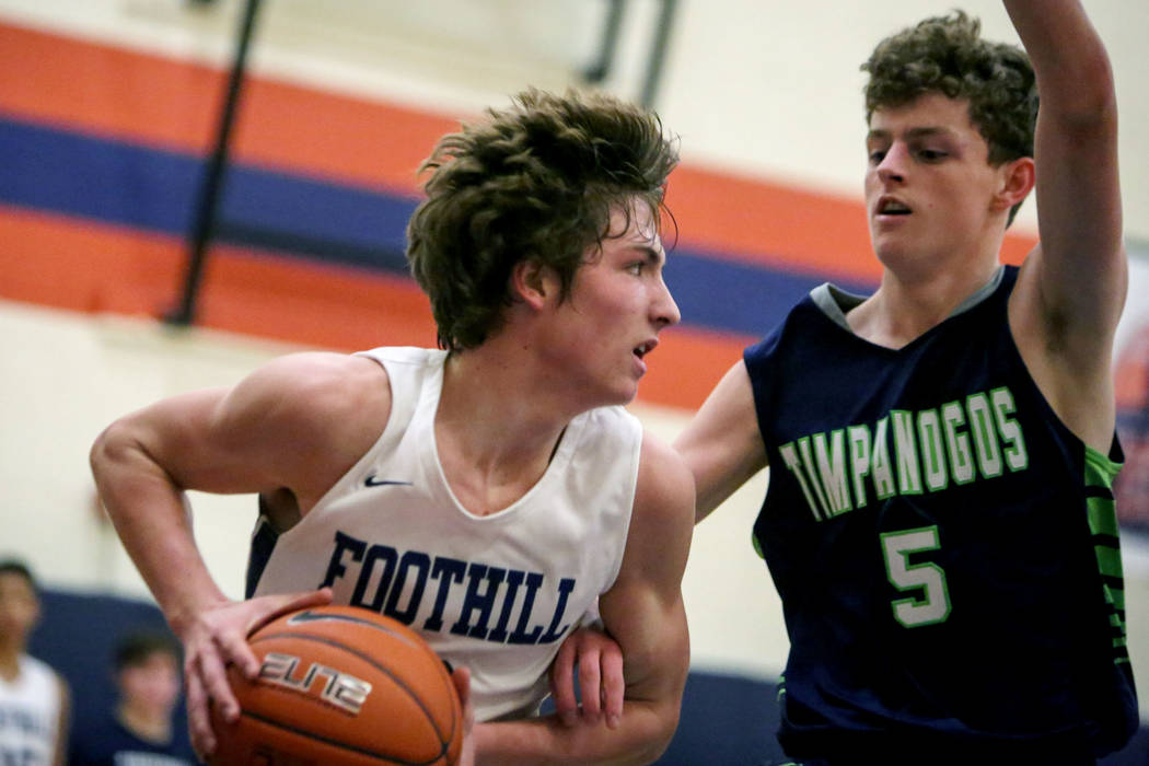 Foothill's Collin Russell (3), left, dribbles the ball against Timpanogos' Trey ...