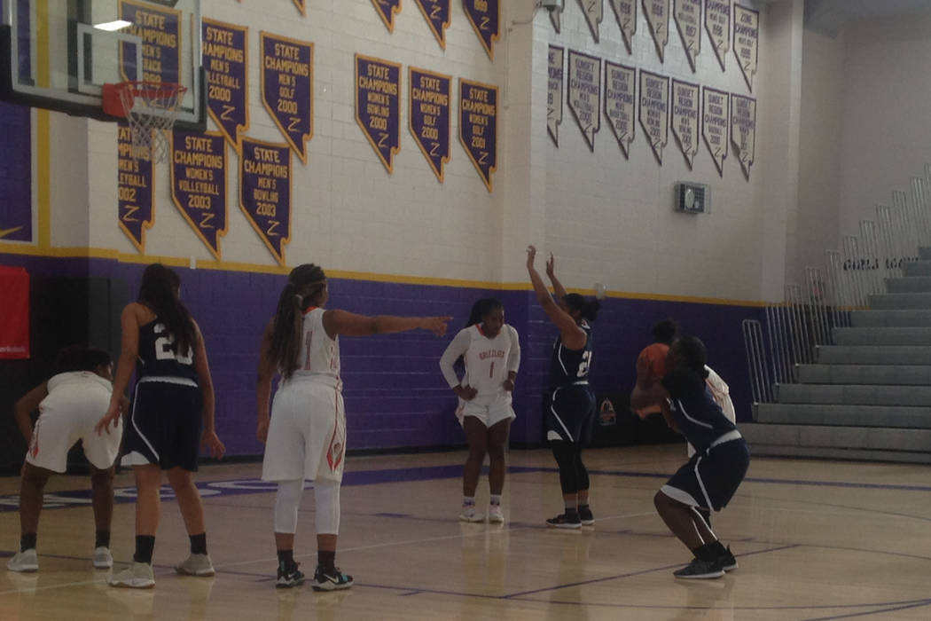 Shadow Ridge's Jamia Carter attempts a free throw in the Mustangs' Premier Divis ...