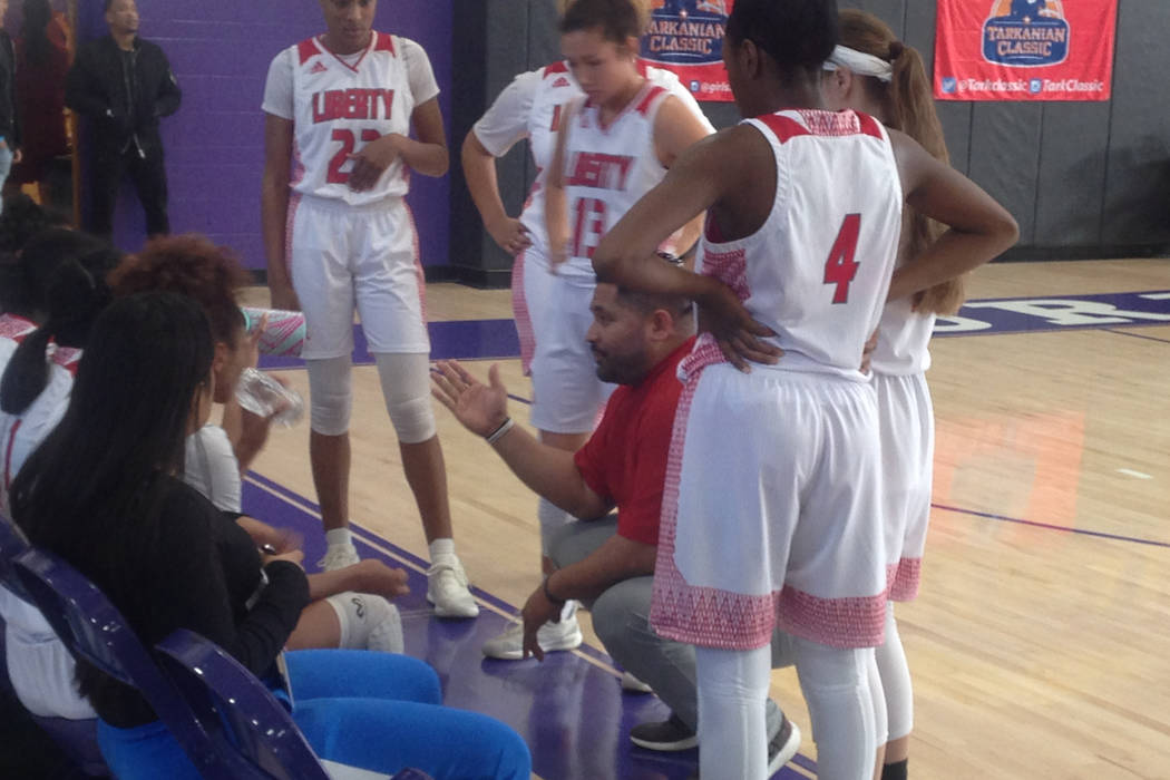 Liberty coach Chad Kapanui talks to his team during a timeout in their Ruby Division final a ...