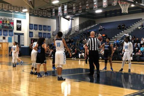 Centennial players line up alongside the lane as a Bear Creek player shoots a free throw at ...