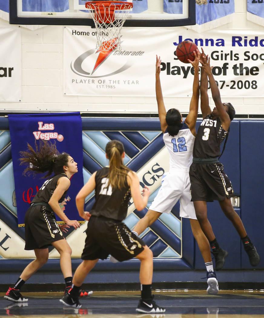 Centennial's Aishah Brown (12) blocks a shot from West's Anaya James (3) during ...