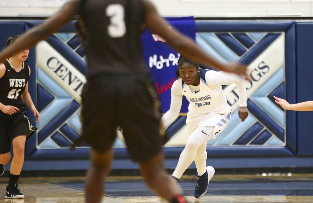 Centennial's Eboni Walker (22) brings the ball up court against West during a basketba ...