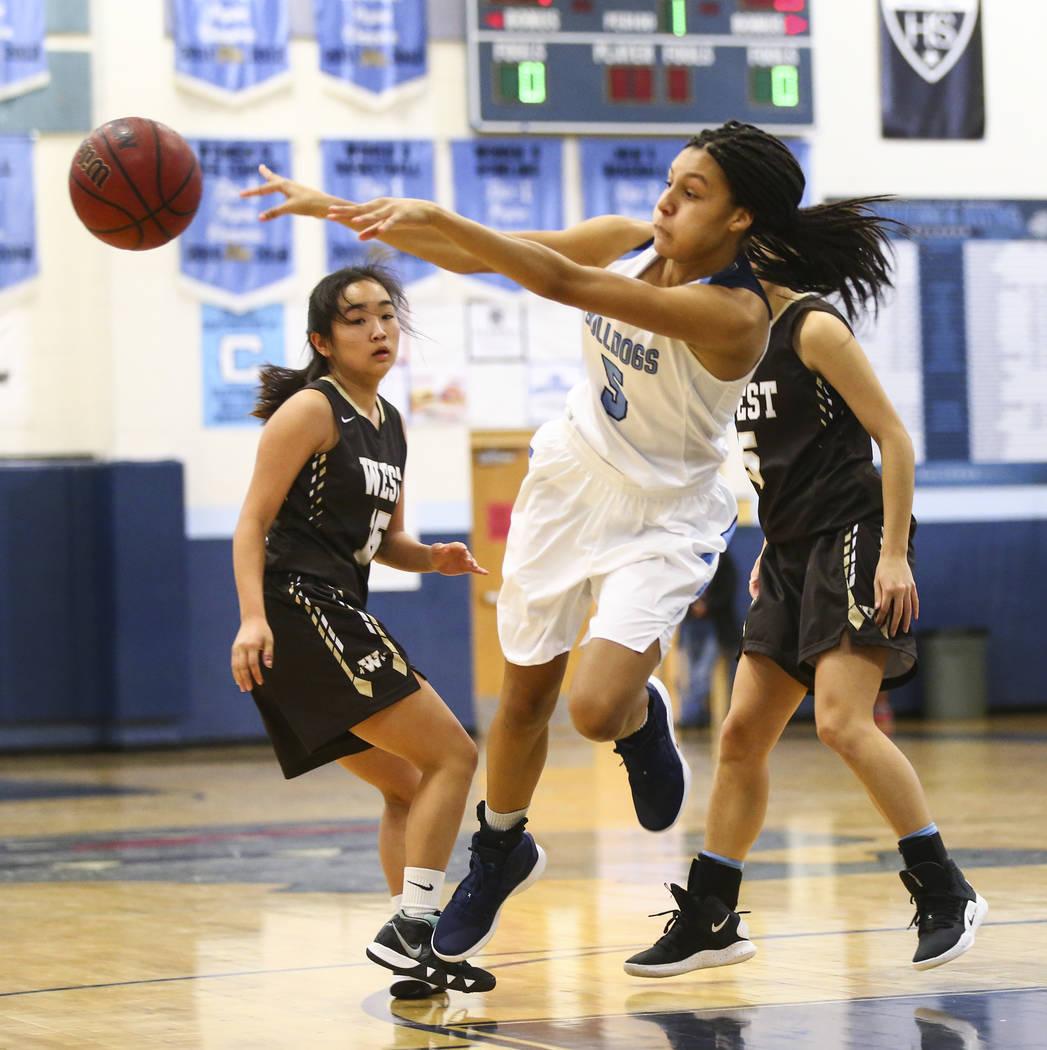 Centennial's Jade Thomas (5) throws the ball past West's Rachel Arakawa (15) d ...