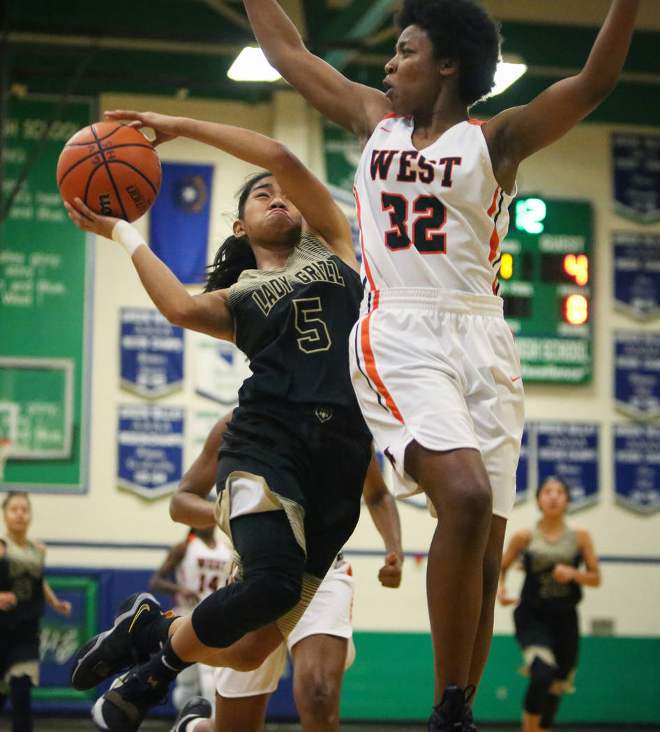 Spring Valley's Chelsea Camara (5) drives past West Anchorage's Ah'Kayzee ...