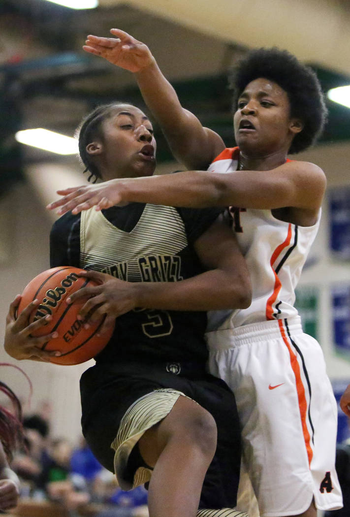 Spring Valley's Aaliyah Gayles (3) shields the ball from West Anchorage's Ah&#82 ...