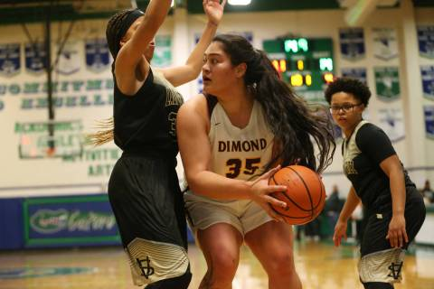Dimond's Alissa Pili (35) looks for an open pass against pressure from Spring Valley&# ...