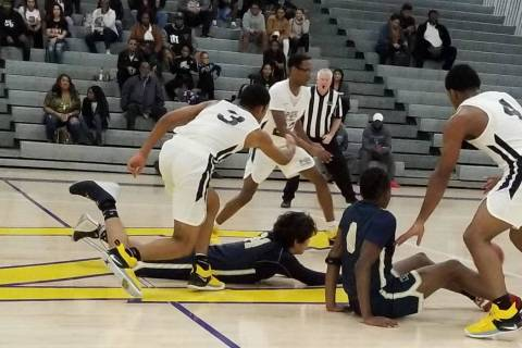 Democracy Prep and Bonita Vista (California) players scramble for a loose ball Saturday duri ...