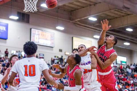 Findlay Prep's Reggie Chaney (20), right, loses control of the ball as Bishop Gorman&# ...