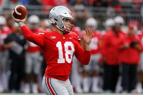 Ohio State quarterback Tate Martell plays against Rutgers during an NCAA college football ga ...